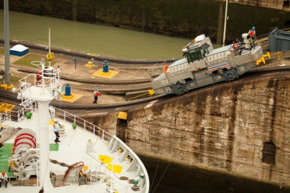 towing locomotives actually pull ships through the locks