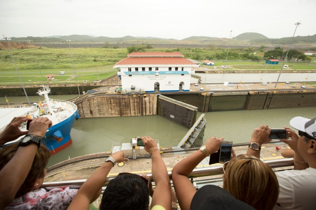 gates open to let a ship pass through to the next stage at the Miraflores locks complex